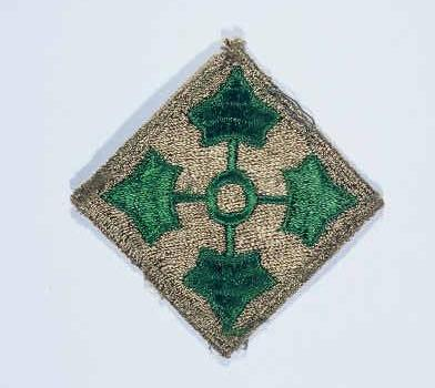 "Insignia of the 4th Infantry Division. The 4th Infantry Division's nickname, the ""Ivy"" division, is derived from the divisional insignia developed during World War I: four ivy leaves on a diamond field, symbolizing the roman numeral ""IV."""