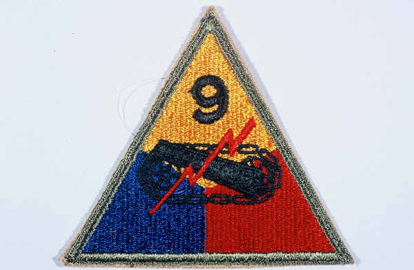 """Insignia of the 9th Armored Division. Although no nickname for the 9th was in common usage throughout the war, """"Phantom"""" division was sometimes used in 1945. It originated during the Battle of the Bulge, when the 9th Armored Division seemed, like a phantom, to be everywhere along the front."""