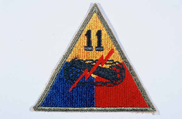 "Insignia of the 11th Armored Division. ""Thunderbolt""  is a nickname adopted by the 11th Armored Division during its rapid march in December 1944 to reinforce US troops defending against the German military offensive in the Ardennes Forest."