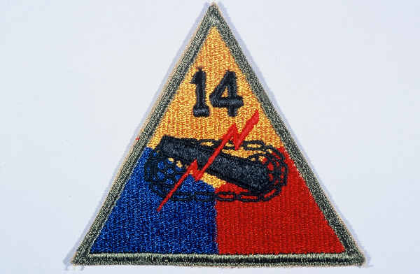 "Insignia of the 14th Armored Division. Although lacking a nickname during the war, the 14th became known as the ""Liberators"" soon afterward to signify its accomplishments in liberating hundreds of thousands of forced and slave laborers, concentration camp prisoners, and Allied prisoners of war in 1945."