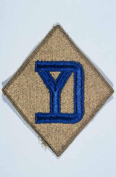 "Insignia of the 26th Infantry Division. The 26th Infantry Division, the ""Yankee"" division, was so nicknamed to recognize the six New England states from whose National Guard units the division was raised during World War I."