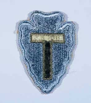 "Insignia of the 36th Infantry Division. The 36th Infantry Division, the ""Texas"" division, was raised from National Guard units from Texas and Oklahoma during World War I. The ""T"" in the division's insignia represents Texas, the arrowhead Oklahoma. The division was also sometimes called the ""Lone Star"" division, again symbolizing its Texas roots."