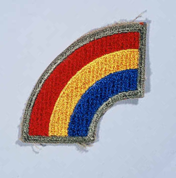"Insignia of the 42nd Infantry Division. The nickname of the 42nd Infantry Division, the ""Rainbow"" division, reflects the composition of the division during World War I. The division was drawn from the National Guards of 26 states and the District of Columbia. It represented a cross section of the American people, as the rainbow represents a cross section of colors."