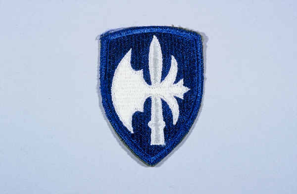 "Insignia of the 65th Infantry Division. The 65th Infantry Division was nicknamed the ""Battle Axe"" after the divisional insignia, a halbert (an axe on a pole), used to cut through the enemy during medieval times."