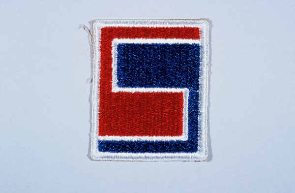 "Insignia of the 69th Infantry Division. The 69th Infantry Division gained the nickname the ""Fighting 69th"" during World War II.  The name has no heraldic significance, but simply conveys the esprit de corps of the division."