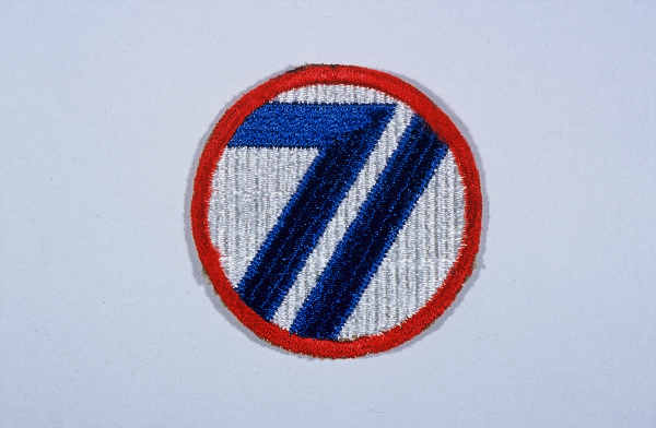 "Insignia of the 71st Infantry Division. The nickname of the 71st Infantry Division, the ""Red Circle"" division, is based upon the divisional insignia (which includes a red circle)."