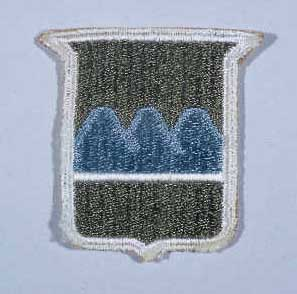 "Insignia of the 80th Infantry Division. The nickname of the 80th Infantry Division, the ""Blue Ridge"" division, reflects the home states of the majority of soldiers who formed the division during World War I: Pennsylvania, West Virginia, and Virginia. The Blue Ridge Mountains run through these three states."