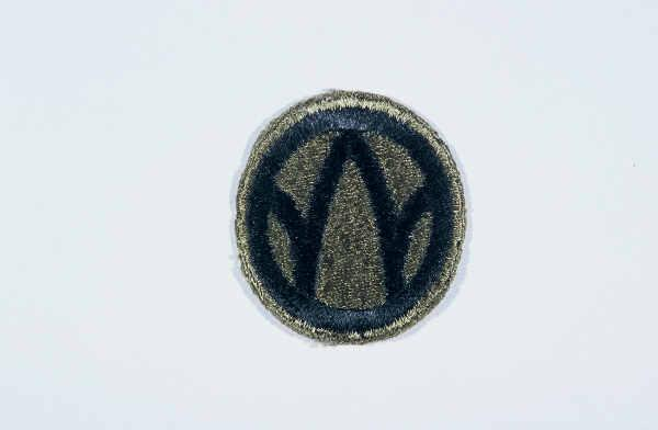 "Insignia of the 89th Infantry Division. The 89th Infantry Division's nickname, the ""Rolling W,"" is based on the division's insignia. Created during World War I, this insignia utilized a letter ""M"" inside a wheel. When the wheel turns, the ""M"" becomes a ""W."" The letters ""MW"" signify the mid-west origin of the troops who formed the 89th during World War I. The division was also known as the ""Middle West"" division, another variation on its origin."