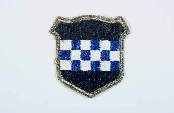 "Insignia of the 99th Infantry Division. The 99th Infantry Division, the ""Checkerboard"" division, gained its nickname from the division's insignia. The insignia was devised upon the 99th's formation in 1942, when the division was headquartered in the city of Pittsburgh. The blue and white checkerboard in the division's insignia is taken from the coat of arms of William Pitt, for whom Pittsburgh is named. The division was also known as the ""Battle Babies"" during 1945, a sobriquet coined by a United Press correspondent when the division was first mentioned in press reports during the Battle of the Bulge."
