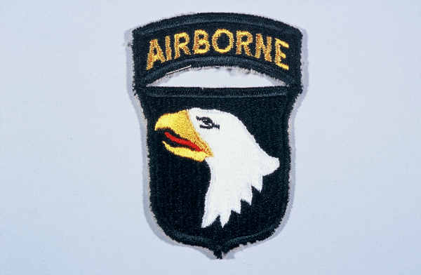 "Insignia of the 101st Airborne Division. The nickname of the 101st Airborne Division, ""Screaming Eagles,"" originates from the division's insignia, a bald eagle on a black shield. ""Old Abe"" was the eagle mascot of a Wisconsin regiment during the Civil War. The 101st was formed as a reserve unit in Wisconsin shortly after World War I and included ""Old Abe"" as part of the division's insignia."