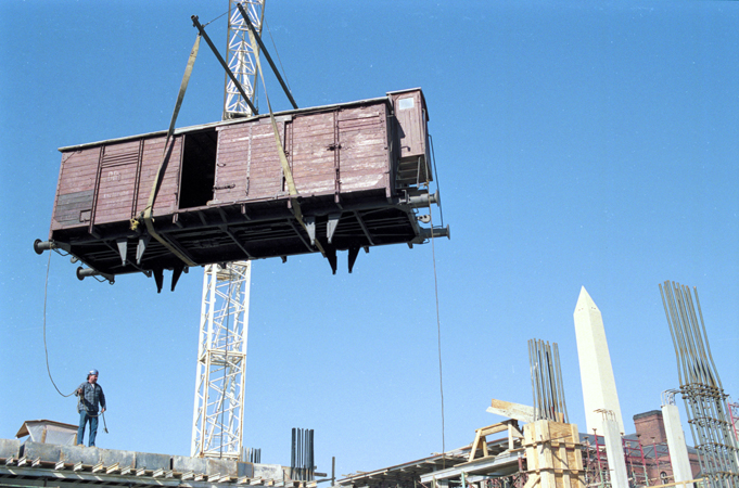 Installation of the railcar at the construction site of the United States Holocaust Memorial Museum. Washington, DC, February 9, 1991.