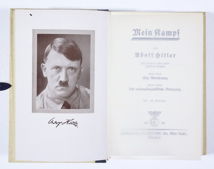 "The title page of ""Mein Kampf"" by Adolf Hitler. This copy has an inscription by Hitler on the inside cover (not shown) that reads ""To the Newlyweds with best wishes for a happy and blessed marriage.""  Munich, Germany, 1941."