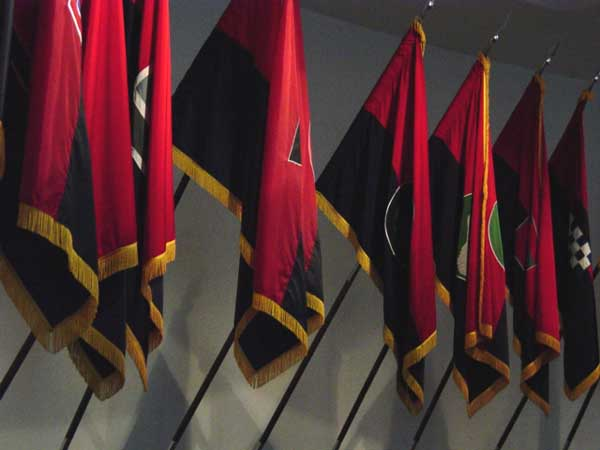 Flags of US Army liberating divisions on display at the United States Holocaust Memorial Museum. April 2004.