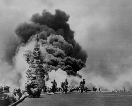 US sailors struggle to contain damage from Kamikaze attacks during the American invasion of Okinawa, the largest of the Ryukyu Islands (the islands closest to the Japanese home islands). May 11, 1945.