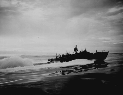 An American PT (Patrol Torpedo) boat off the coast of New Guinea, during an American counteroffensive against Japanese advances in the Solomon Islands in the eastern Pacific Ocean, 1943.