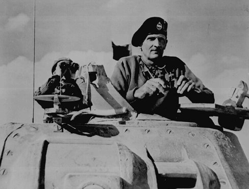 General Bernard L. Montgomery, commander of British forces in Egypt, watches British tanks move toward German lines during the military campaign in North Africa. November 1942.
