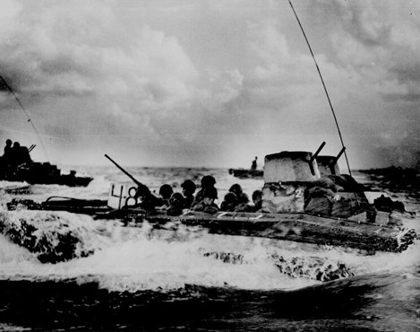 An amphibious troop carrier loaded with American Marines heads for the beaches of Tinian, an island in the Pacific Ocean. July 1944.