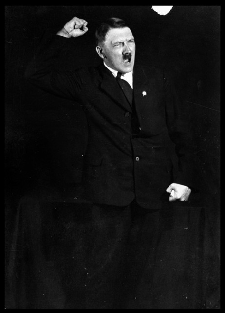 "Hitler rehearsing his oratory. Hitler carefully cultivated his image as the Nazi Party leader as he came to see the propagandistic value of photographic publicity. Heinrich Hoffmann, Hitler's official photographer, created the images central to the growing ""Führer cult."" In 1927, Hoffmann snapped these action shots of Hitler rehearsing his oratory."