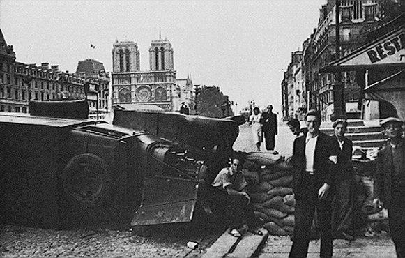 During the battle to liberate the French capital, a barricade is hastily built near the cathedral of Notre Dame. Paris, France, August 1944.