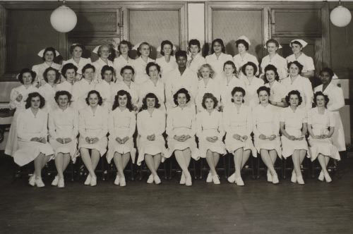 Blanka (middle row, third from right) graduates to become a pediatric nurse. December 1947.