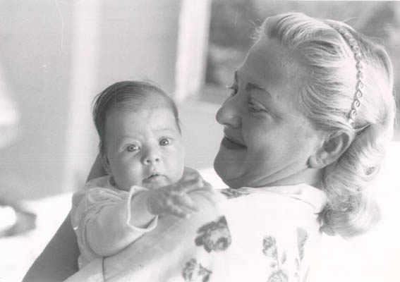 Norman's daughter, Esther, at three weeks of age, with her mother, Amalie. September 1956.