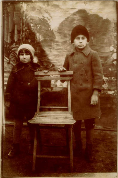 1929 portrait of Norman with his niece, Szandla Weinstein. Picture taken in front of a photographer's backdrop in the Kolbuszowa marketplace.