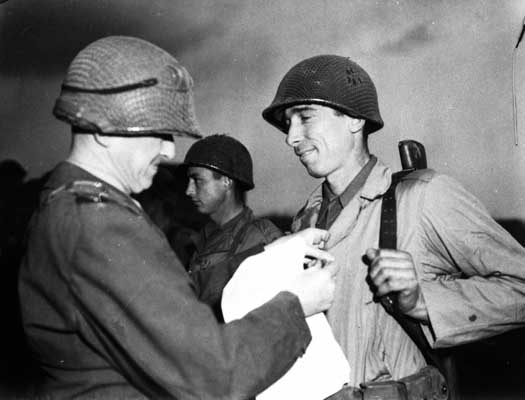 Sergeant Alexander Drabik, the first American soldier to cross the bridge at Remagen, receiving the Distinguished Service Cross for his heroism. April 5, 1945. US Army Signal Corps photograph taken by  J Malan Heslop.