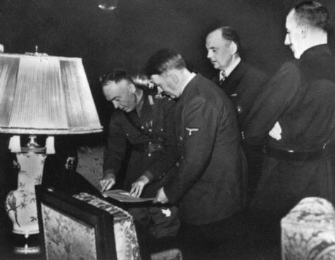 In Hitler's presence, Romanian ruler Ion Antonescu signs the Three-Power Agreement. Berlin, Germany, November 23, 1940.