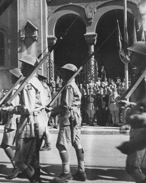 Allied troops march in Tunis following Allied success against Axis forces in the African Campaign. Tunis, Tunisia, May 20, 1943.