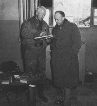 Generals Dwight D. Eisenhower and George S. Patton discuss Allied military operations in North Africa. Djebel Kouif, Algeria, March 16, 1943.