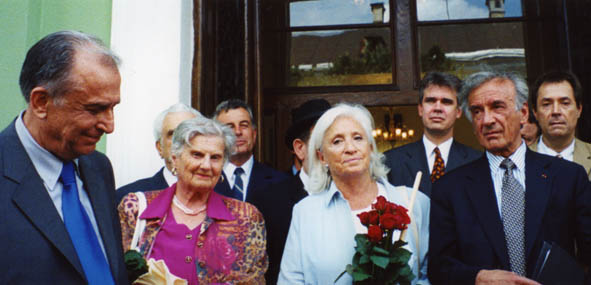Elie Wiesel with his wife Marion and President Ion Iliescu in Sighet following the presentation of the Final Report of the International Commission on the Holocaust in Romania.