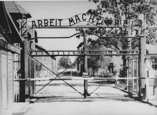 "View of the main entrance to the Auschwitz camp: ""Arbeit Macht Frei"" (Work makes one free)."