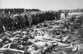 US troops force German civilians to view corpses of victims in the Kaufering IV subcamp of the Dachau concentration camp.