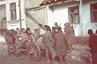 Romanian soldiers supervise the deportation of Jews...