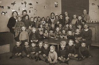 Portrait of a preschool class in Copenhagen. Gus Goldenburger (top row, second from left) was one of the few Jewish students in the class. His family moved to Denmark from Czechoslovakia, fearing the rising tide of Nazism. When the Nazis planned to deport Danish Jewry, the Goldenburgers managed to escape to Sweden, where they remained until the end of the war. After the war, the Goldenburgers returned to Copenhagen. Photograph taken in Copenhagen, Denmark, 1938–1939.