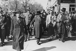 Two Jewish men (center, and at right in overcoat)...
