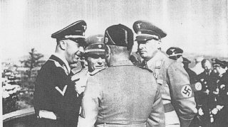 During a visit to Germany, Italian dictator Benito Mussolini (back to camera)  speaks with (left to right): SS chief Heinrich Hi