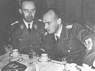 SS chief Heinrich Himmler (left) and Hans Frank, head...