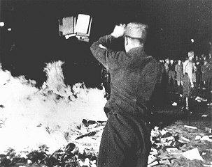 At Berlin's Opernplatz, an SA man throws books into...