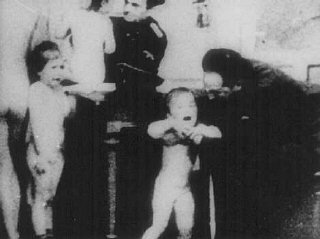 German officers examine Polish children to determine...