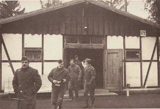American soldiers finish their inspection of Dachau's first crematorium.