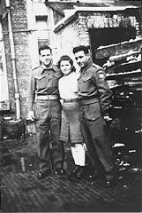 "A Jewish Brigade soldier with two members of ""Kibbutz..."