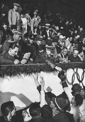 Adolf Hitler and Joseph Goebbels sign autographs for members of the Canadian figure skating team at the Winter Olympic Games. Garmisch-Partenkirchen, Germany, February 1936.