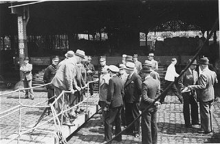 "Belgian officials at the gangplank of the ""St."