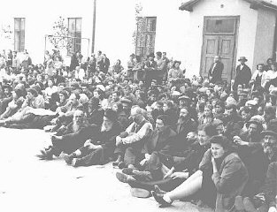 The Jewish residents of a village in Bessarabia are held before their deportation to Transnistria.