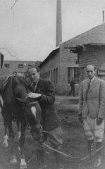 Oskar Schindler (left) at his enamel works in Zablocie...