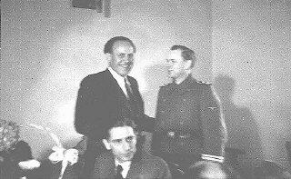 Oskar Schindler (center) at his 34th birthday party...