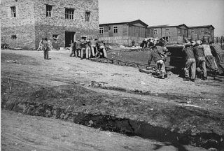 Jewish prisoners at forced labor in the Plaszow cam...