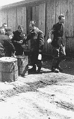 Prisoners receive meager food allocations at the Plaszow...