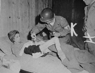 Lt. Col. J.W. Branch, Chief Surgeon of the 6th Armored...
